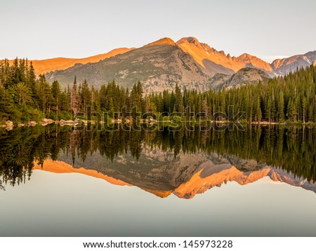 Sunset lake reflection of mountains at Bear Lake in Rocky Mountain National Park, Colorado