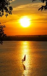 Sunset lake view windsurfing. Windsurfing sunset