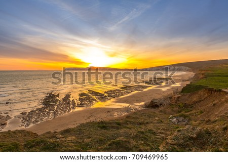 Sunset landscape and cliffs on Tennyson Down on the Isle of Wight, off the south coast of the United Kingdom. #709469965