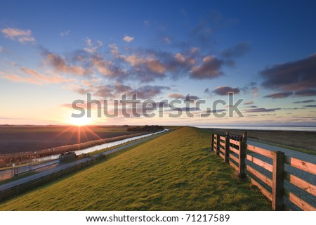 Sunset landscape at the coast - stock photo