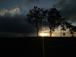 Sunset landscape, rainy days, clouds scenary. Nature background.