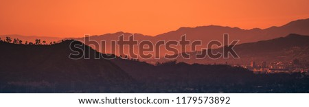 Sunset landscape view of silhouette mountains in Los Angeles California #1179573892