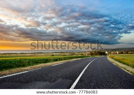 Sunset landscape with coastal road
