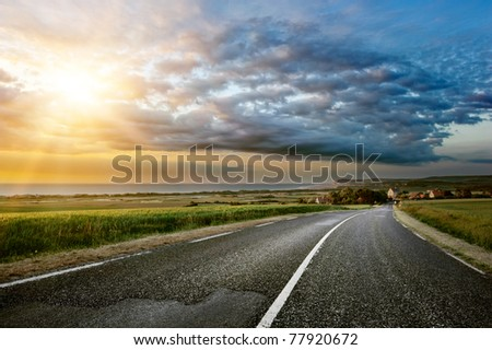 Sunset landscape with coastal road