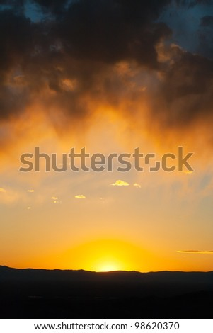 Sunset landscape with colorful frame of clouds