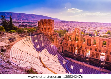 Sunset landscape with the Odeon of Herodes Atticus at the Acropolis of Athens, Greece. It is one of the main landmarks of Athens. Scenic panorama of Herod Atticus Odeon overlooking Athens city