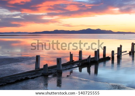 Sunset landscape with wooden posts at the Great Salt Lake, Utah, USA.