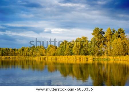 Sunset light falling on the lakeside. Mazury, Poland.