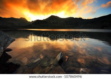 Sunset light over Bucura Lake, National Park Retezat, Romania
