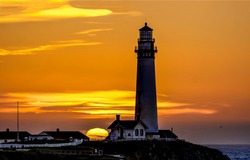 Sunset lighthouse silhouette. Lighthouse at sunset. Sunset lighthouse silhouette view. Lighthouse sunset scene