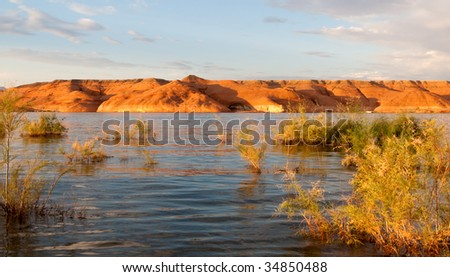 Sunset lit rock formations at Lake Powell in Glen Canyon National Recreation Area, Utah