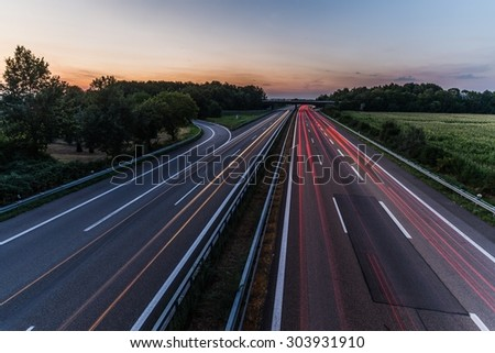 Sunset long-exposure over a german highway  #303931910