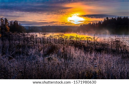 Sunset meadow field fog landscape. Rural meadow sunset fog view. Sunset fog field landscape. Meadow sunset fog view