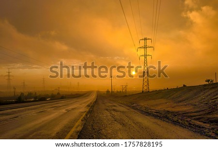 Sunset mist road view. Misty sunset road way. Sunset road mist. Sunset misty road