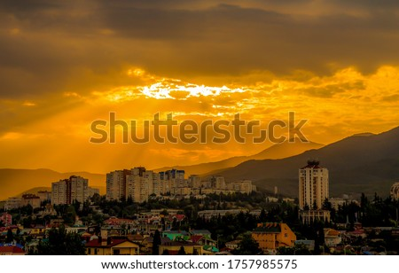 Sunset mountain city sky landscape. Mountain city sunset sky clouds. Sunset in mountain city. Mountain city sunset sky