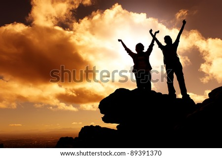 sunset mountain climbing victory celebration