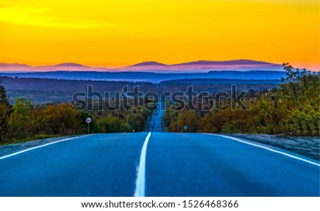 Sunset mountain valley highway road landscape. Mountain valley road sunset. Sunset valley road view. Sunset mountain valley rod scene