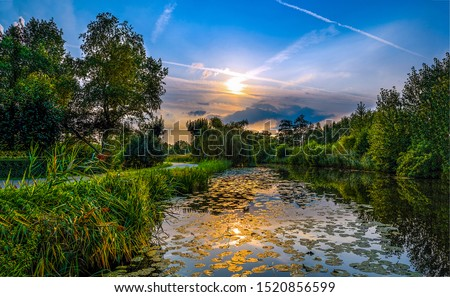 Sunset nature river reflection landscape. Forest river sunset scene. Rural river sunset landscape. Sunset river water