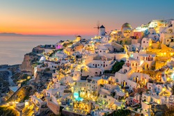 Sunset night view of traditional Greek village Oia on Santorini island in Greece. Santorini is iconic travel destination in Greece, famous of its sunsets and traditional white architecture