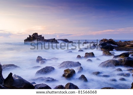 SUNSET OF CORAL REEF COASTLINE - stock photo