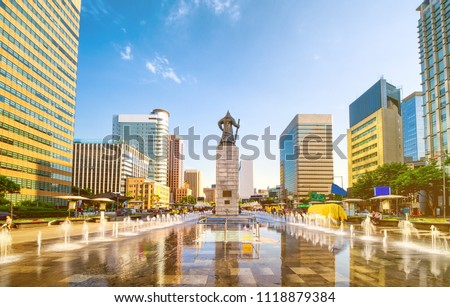 Sunset of Gwanghwamun Plaza with the statue of the Admiral Yi Sun-sin and modern buildings in downtown Seoul,South Korea.  - Shutterstock ID 1118879384