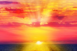 Sunset of Mediterranean. Beautiful colorful seascape with calm water surface. Red sundown. Sun shining glow