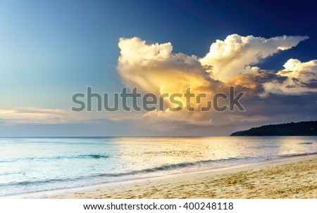 Sunset on a beach with fantastic sky. Sunset light reflection, Phuket, Thailand. Sea sunset, Thailand. Amazing sunset. Soft sunset reflection in sea water at Karon beach, Phuket. Exotic sunset clouds