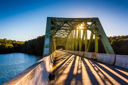Sunset on a bridge over Prettyboy Reservoir, in Baltimore County, Maryland.