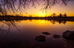 Sunset on a calm lake at the Maple Lion Park, Vaughan, Ontario, Canada.