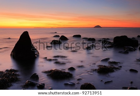 Sunset on a rocky west coast shore of Scotland