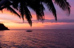 sunset on a tropical paradise beach