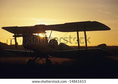 Sunset on an aircraft Biplane De Havilland Tiger Moth DH-82 - stock photo