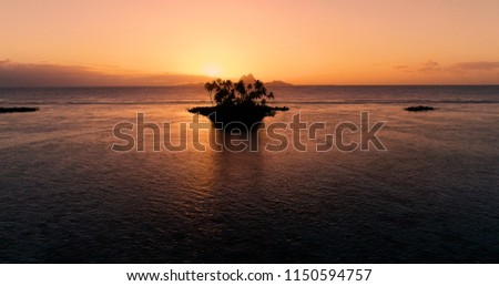 sunset on an islet in French Polynesia
