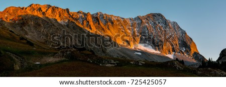 Sunset on Capitol Peak, a Colorado 14er (14,000 foot) Mountain in the Elk Range. Photo from the Capitol Creek Valley in the Maroon Bells - Snowmass Wilderness.