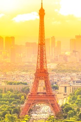 sunset on cityscape skyline of Paris with Eiffel Tower on background. Seasonal picturesque background in summer. Scenic wallpaper with Eiffel Tower. Vertical shot.