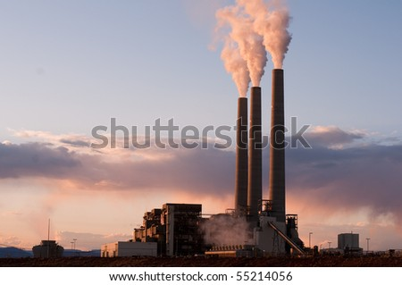sunset on coal burning electrical plant