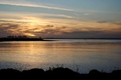 Sunset on Eureka, California's Pacific coast on Humboldt Bay. Humboldt Bay stretches from the sloughs and creeks at Arcata Marsh to the Humboldt Bay National Wildlife Refuge at Loleta.