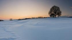 Sunset on frozen field.