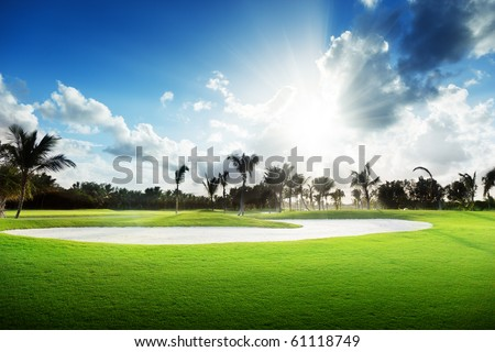 sunset on golf field - stock photo
