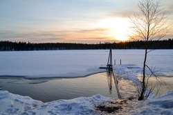 Sunset on Korvalampi's frozen lake in Korvala's lappish village - Finnish Lapland