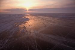 Sunset on Lake Baikal reflections on ice
