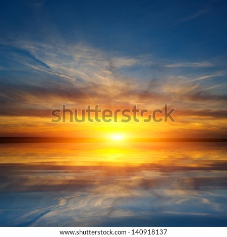 sunset on lake over water surface