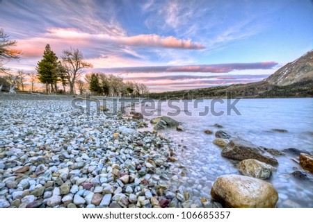 Sunset on Lakes of Waterton National Park - stock photo