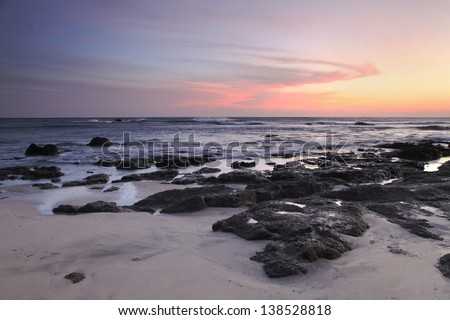 Sunset on Lava Covered Beach on Pacific Ocean Coast of Costa Rica