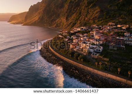 Sunset on Madeira island. Jardim do Mar - small village on sea shore. Sunset sunrise on island in Atlantic ocean. Madeira island in Atlantic ocean. Small touristic village in Madeira. Foto stock ©