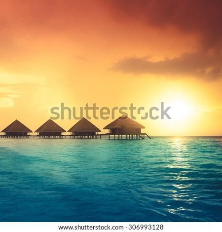 Sunset on Maldives island, water villas resort #306993128