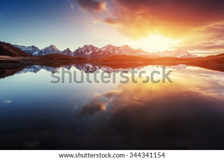 Stock Photo Sunset on mountain lake Koruldi. Upper Svaneti, Georgia, Europe. Caucasus mountains.