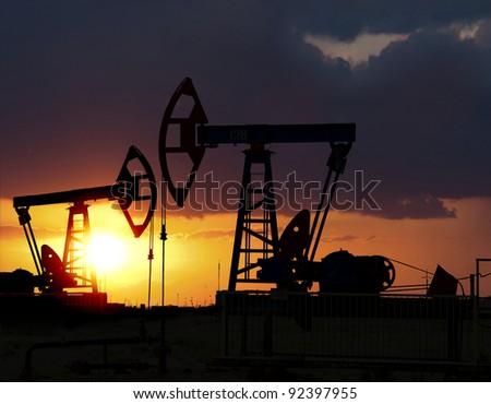 Sunset on oilfield in Asia