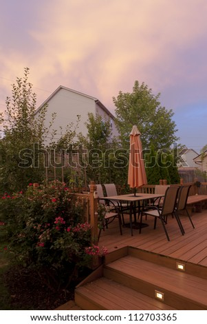 Sunset on Patio of family home in USA. Also called a Deck or Veranda.