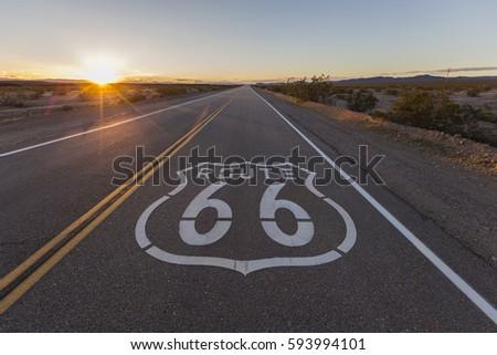 Sunset on Route 66 in the California Mojave Desert.   #593994101